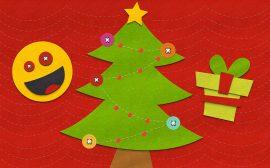 Pannolenci con emoticon sorridente, albero di Natale e pacchetto regalo
